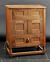 Arts & Crafts. An oak cabinet, circa 1930s,  the rectangular top with hinged se