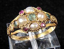 Ring. A Victorian yellow metal cluster ring, set with seed pearls, ruby and eme