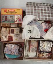 LOT CONTAINING SEVERAL BOXES OF DOLL