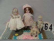 (4 PCS) ALL BISQUE DOLLS WITH JOINTED ARMS