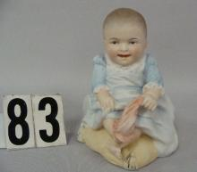 HERTWIG 5 IN. BISQUE PIANO BABY OF A YOUNG BOY