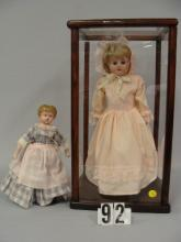 16 IN. TIN HEAD DOLL WITH KID BODY,