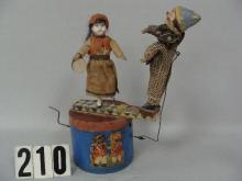 EARLY GERMAN WIND-UP MUSICAL TOY ON TIN