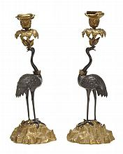 A pair of William IV gilt and patinated bronze candlesticks cast as standing...