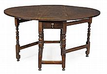 'A Queen Anne walnut oval gateleg dining table, circa 1690