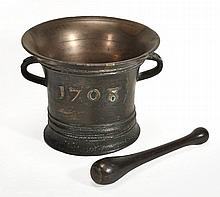 A Queen Anne bronze mortar, dated 1708, the flared rim knopped to the exterior