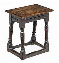 A Charles I oak joint stool , circa 1630, the solid rectangular seat with...