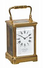 A rare gilt brass mid-sized carriage timepiece