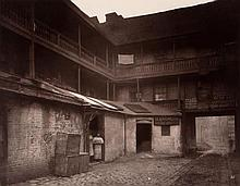 Henry Dixon (1820-1892). White Hart Inn Yard, Southwark, 1881. Carbon print mounted to contemporary
