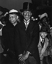 Weegee (1899-1968). Easter Sunday, Harlem, 1940. Gelatin silver print, printed later, annotated in