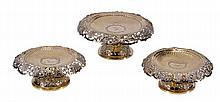 A matched Victorian silver gilt comport and a pair