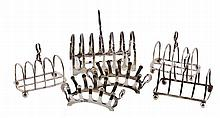 A pair of silver four division toast racks by Thomas Bradbury & Sons Ltd