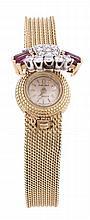 Omega, Turler, a lady's 18 carat gold, diamond and ruby bracelet watch