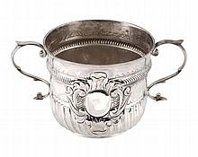 A Queen Anne silver porringer by Nathaniel Lock, London 1704