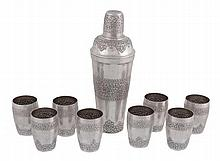 An Indian silver coloured cocktail set of a shaker and eight beakers