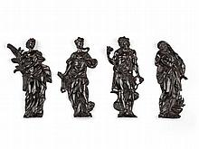 A Set of Four Bronze Wall Appliques