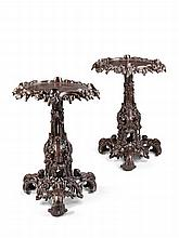 A Pair of Grotto Style Cast Iron Tables