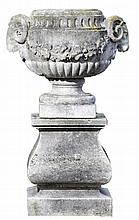 A stone composition urn on a carved limestone pedestal, mid 20th century