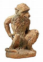 A Continental sculpted terracotta garden model of a seated monkey, 20th century