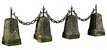 A set of four limestone and wrought iron mounted border stones, 19th century