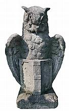 A Continental stone composition model of an owl with an open book