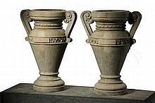 A pair of Italian carved Istrian stone urns, late 19th century