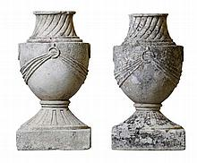 A pair of French carved limestone urn finials, early 19th century