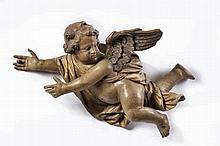A northern European carved and decorated wood model of an angel, circa 1700