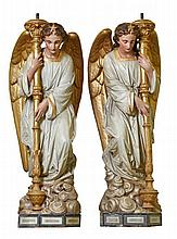 A pair of French polychrome decorated sculpted terracotta figural torcheres...