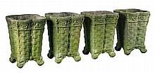 A set of four Continental stone composition planters in the form of baskets