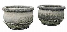 A pair of Continental, probably French carved limestone planters, 20th century