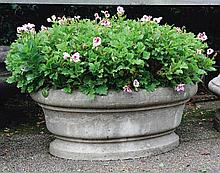 A French carved Bourgogne stone planter, 20th century, of oval section