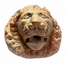 A sculpted marble wall fountain modelled as a lion's mask in Romanesque taste