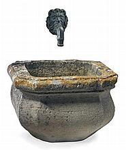 A French carved limestone basin with an associated bronze wall fount
