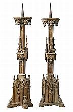A pair of Continental, probably French gilt cast iron pricket candlesticks...