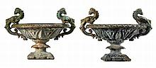A pair of Continental cast iron twin handled garden urns, late 19th century