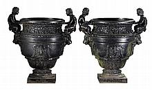 A pair of French cast iron vases after Calla's bronze urn at Versailles