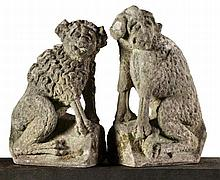 A pair of French sculpted limestone models of watchdogs, early 18th century