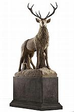 A large and impressive sculpted limestone and antler mounted model of a stag