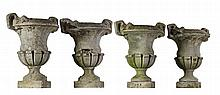 A set of four stone composition garden urns, first half 20th century