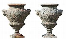A pair of Continental cast iron garden urns, 19th century