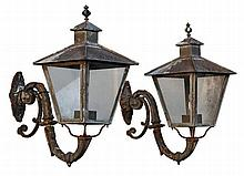 A pair of French copper, glazed and cast iron mounted wall lanterns