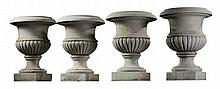 A set of four carved Carrara marble urns, 19th century, each with everted rim