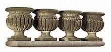 A set of four Continental carved limestone garden urns, 20th century