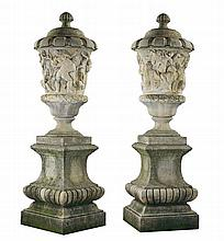 A pair of large Italian sculpted stone lidded urns after examples in the...