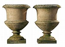 A pair of stone composition garden urns, early 20th century