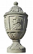 A French carved limestone urn in 18th century style