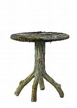 A stone composition faux bois garden table , late 19th century
