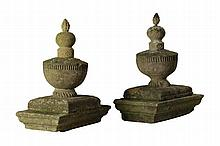 A pair of French carved sandstone pier finials, 19th century