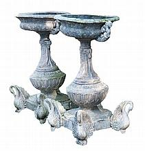 A pair of Continental zinc planters on stands, late 19th century